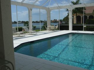 Vacation Homes in Marco Island house photo - Large heated pool.