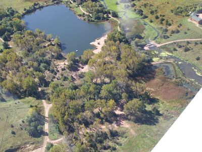 Aerial view of the private lake, beach and fire pit area.