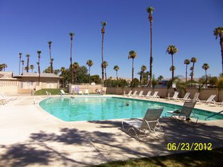 Thousand Palms house photo - One of two pools at the Club House ... lots of space to sun bathe and just chill
