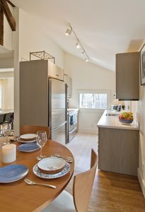 Galley kitchen and casual dining area