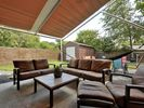 Outdoor Patio - The covered patio is a great place to relax, rain or shine!