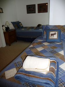 Comfortable new twin beds with matching bedding