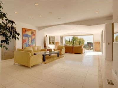 Living room with bi-folding 18 ft. wide doors overlooking the ocean