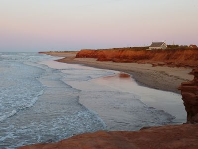 Thunder Cove beach with stunning red cliffs and sand dunes.