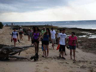 Vega Baja condo photo - Vacationers walking along the condo beach towards local beach.