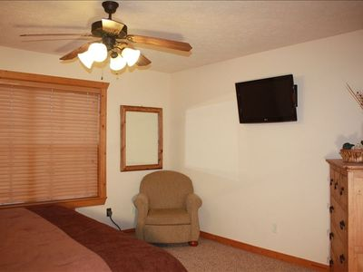The bedroom is furnished with a flat screen television and blu-ray player.
