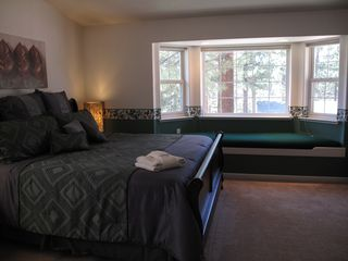 Large bay window in master bedroom suite with a sitting bench - Montgomery Estates house vacation rental photo