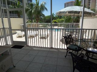 Naples condo photo - Cool shaded Lanai, Sunny Patio Terrace, Stairs to Pool