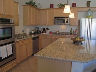 Lake Las Vegas house photo - Fully equipped chef's kitchen opens onto Great Room for easy entertaining