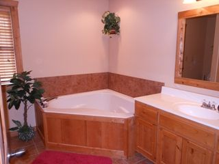 Branson lodge photo - Huge master bath with heart shaped jacuzzi tub and separate shower