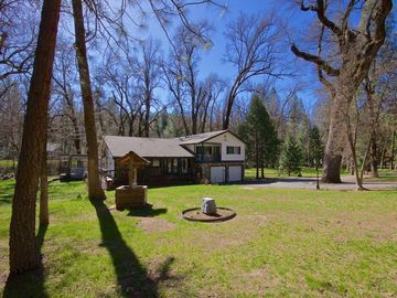 Oakhurst chateau / country house rental - Front of home with large open spaces and paved driveway.