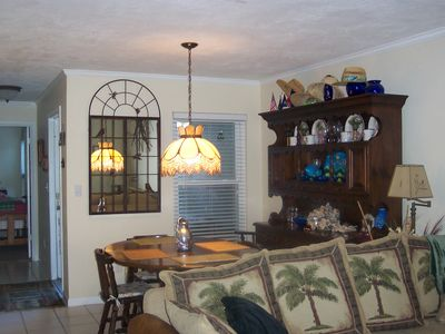 Vilano Beach townhome rental - Dining room, table for six, hutch w more dishes & wine glasses etc.