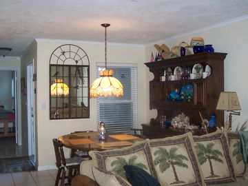 Dining room, table for six, hutch w more dishes & wine glasses etc.