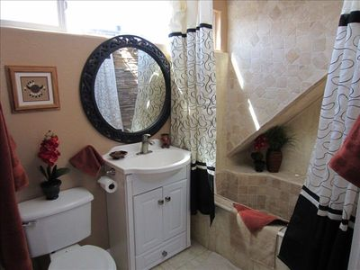 Light & bright 3rd fl Master ensuite bath w/ stone shower/tub
