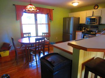 Kitchen area with kitchenette table.