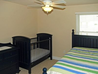 4th bedroom with twin trundle beds and crib.