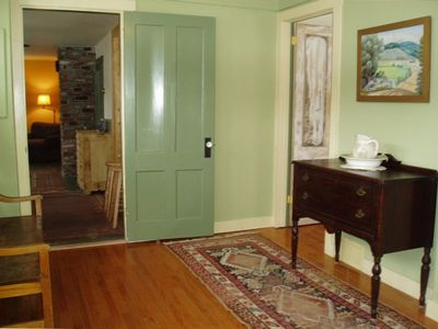 Entry room to the kitchen, dining area and sitting room