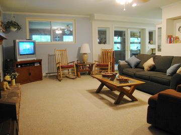 Family room opens to sunroom/dining and kitchen. Sofa bed.
