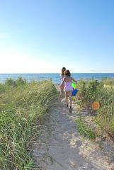 Private path from house to quiet, mile-long beach. Pure joy and fun for our kids - Peconic house vacation rental photo