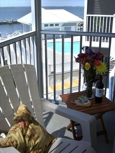 Enjoy the views and relax from the private screened porch and balcony