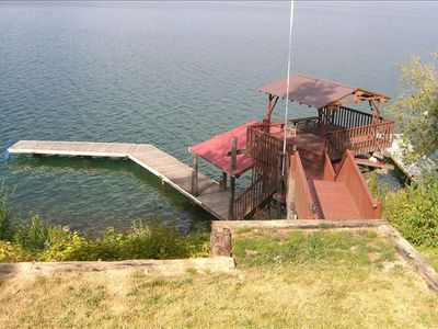 View of dock, covered seating area over Lake Pend O'Reille