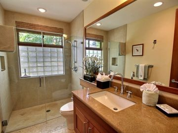 Full bathroom for Third Bedroom with custom travertine walk-in shower.