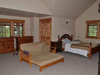 Spacious upstairs bedroom looking right, full size futon and queen bed