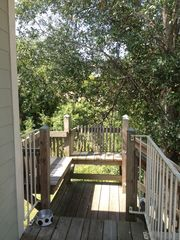 Folly Beach studio photo - Nice outdoor seating area at the top of the steps
