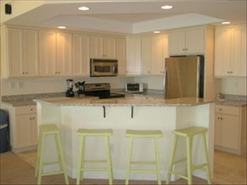 Kitchen Area w/4 Stools, Adjacent Table seats 6