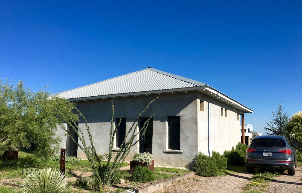 Cool art filled west texas adobe vrbo for Cost to build adobe home