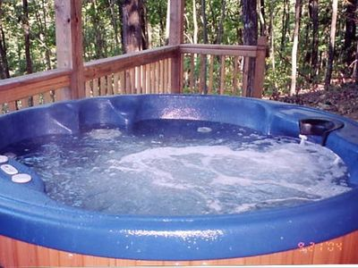 Hot tub on the open deck overlooking the mountains