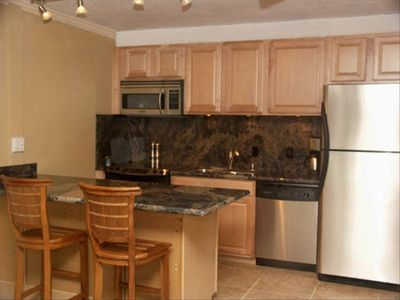 Kitchen - stainless steel appliances and granite