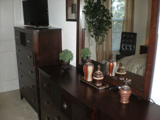 Master bedroom dressers with flat screen TV - Kissimmee condo vacation rental photo