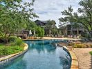 Lazy River - Spend breezy afternoons sunning around the pool that features a lazy river.