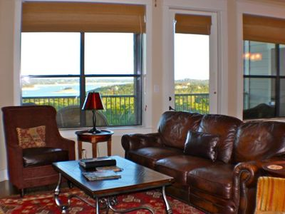Jonestown condo rental - Very comfortable living room with leather sofa and side chairs with large TV.