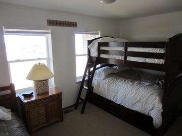 Third Bed Room. Double bed size bunk beds and a twin in this room.