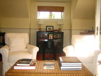 Second-floor sitting room can function as library and home office.