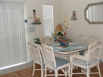 One of two dining tables, plus couner seating. Total table seating 14.