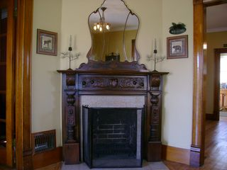 Colorado Springs house photo - Ornate, hand-carved fireplace mantle sets the mood.