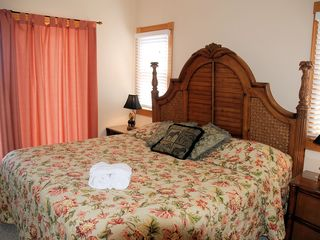 Corolla house photo - Southeast King Bedroom Suite with pool, ocean, & golf views.