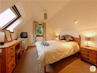 Spacious master kingsize bedroom with loch views