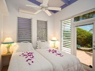 Providenciales - Provo villa photo - Second bedroom with private garden entry. Twin or kingsize beds, ensuite bath.