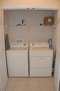 Full size laundry with iron and ironing board