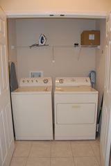 Encantada Resort townhome photo - Full size laundry with iron and ironing board
