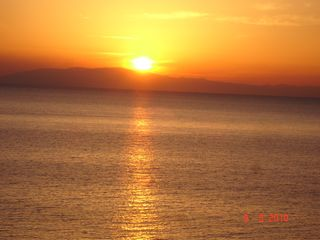 Skala villa photo - Sunset , Drinking wine and watching this beautiful sunset at Villa Sakoss