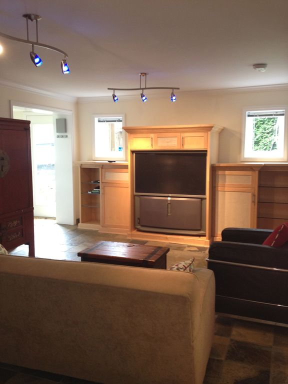 living area with surround sound TV and Stereo with full cable package.