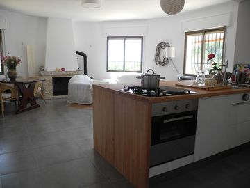 Open plan kitchen to dining and sitting area