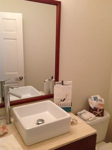 A powder room is directly off the kitchen and living area.
