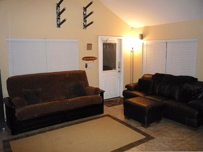 Queen sized extremely high end futon couch and Nubuck Leather brown couch.