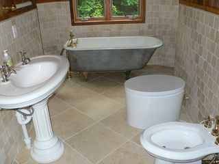Phoenicia house photo - Downstairs bath with antique sink and claw foot tub and bidet.